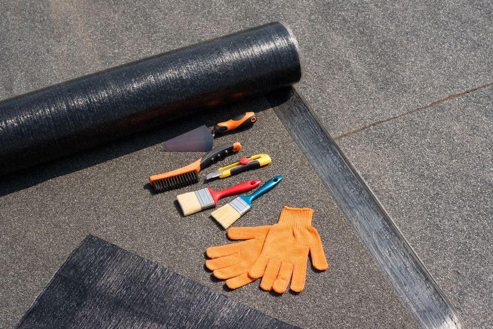 Roll roofing tools
