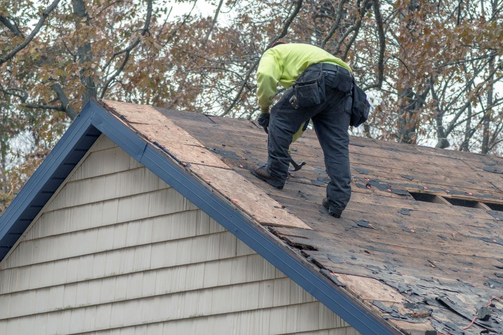 roofer fixing old roof
