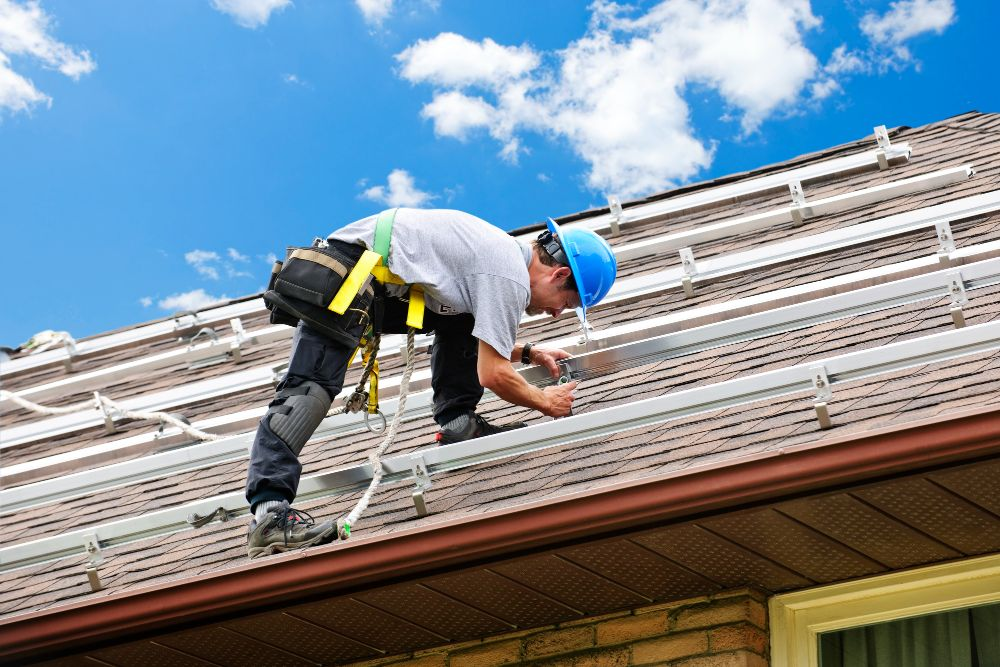 man installing steel on the roof